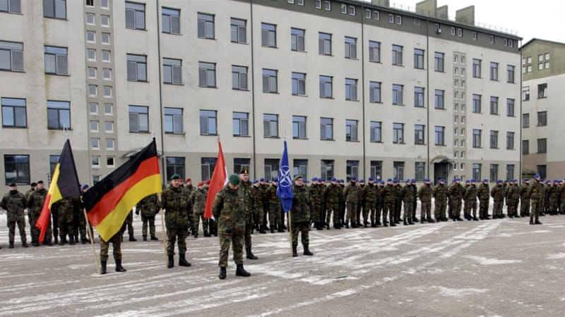 German soldiers attend a welcoming ceremony for the first troops of the NATO enhanced Forward Presence battalion group at the Rukla base in Lithuania on February 7 [Valda Kalnina/EPA]