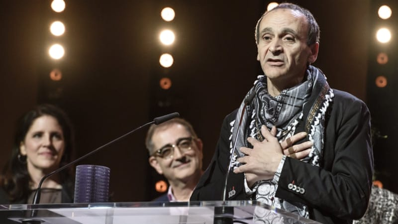 Palestinian filmmaker Raed Andoni won the Glashutte Original Documentary Award at the 67th annual Berlin International Film Festival [Clemens Bilan/EPA]