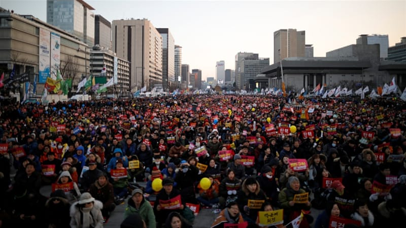 The scandal has led to weekly protests by tens of thousands of Koreans [Kim Hong-ji/Reuters]