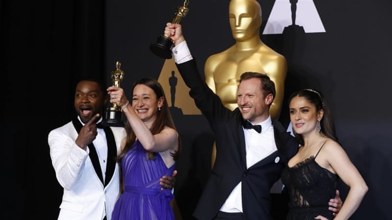 Orlando von Einsiedel and Joanna Natasegara hold their Oscars for Best Documentary Short Subject for The White Helmets as they pose with presenters David Oyelowo and Selma Hayek [Reuters]