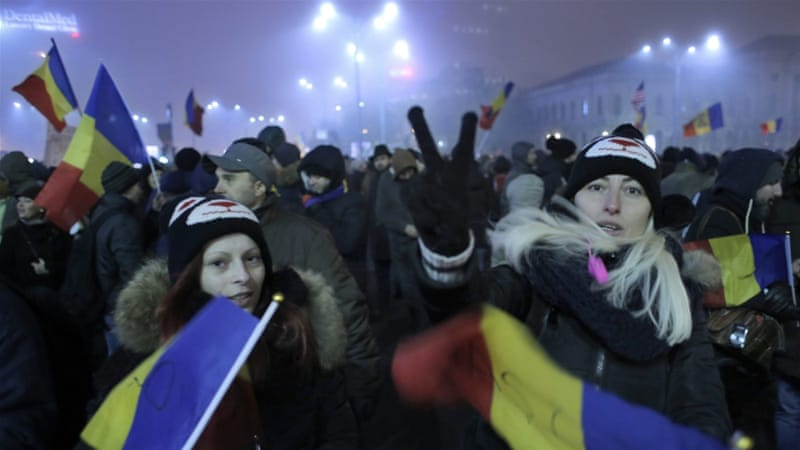 Two women shout slogans during a protest against the Romanian government in Piata Victoriei, Bucharest on February 6 [EPA]
