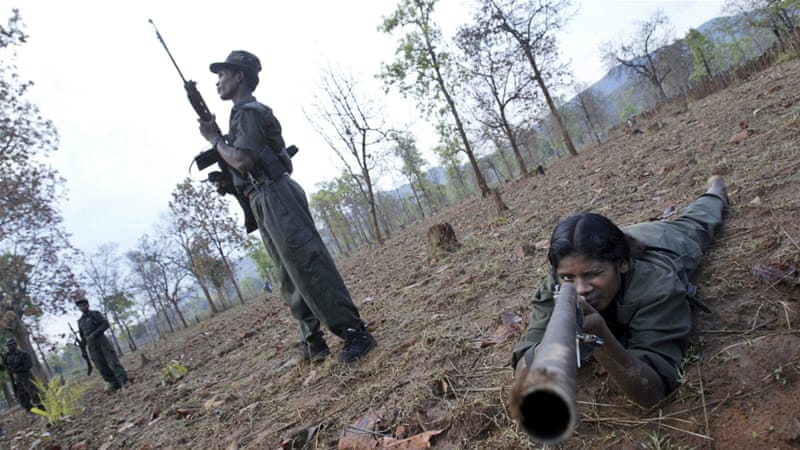 The Maoist rebels say they are fighting for the rights of tribal people and landless farmers [Mustafa Quraishi/AP Photo]