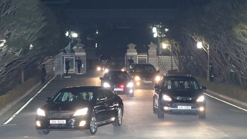 Park left the Blue House in a motorcade of fast-driving black cars, flanked by police motorbikes, after bidding farewell to staff [Reuters]