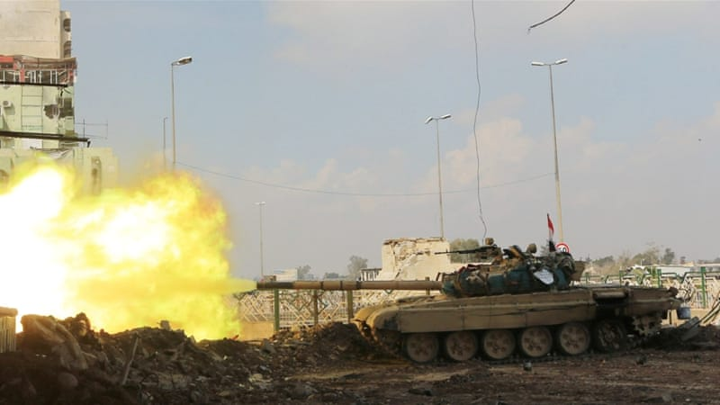 Iraq forces used armoured vehicles and tanks to attack snipers trying to pin down troops on Tuesday [Reuters]