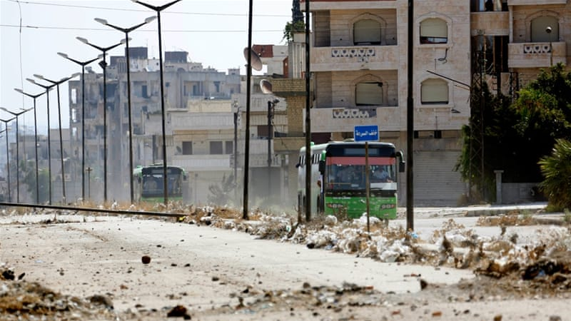 Hundreds quit last rebel-held district of Syria's Homs