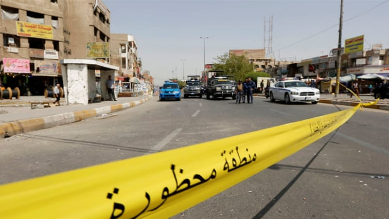 Auto  bomb attack kills at least 23, injures dozens in Iraq's capital