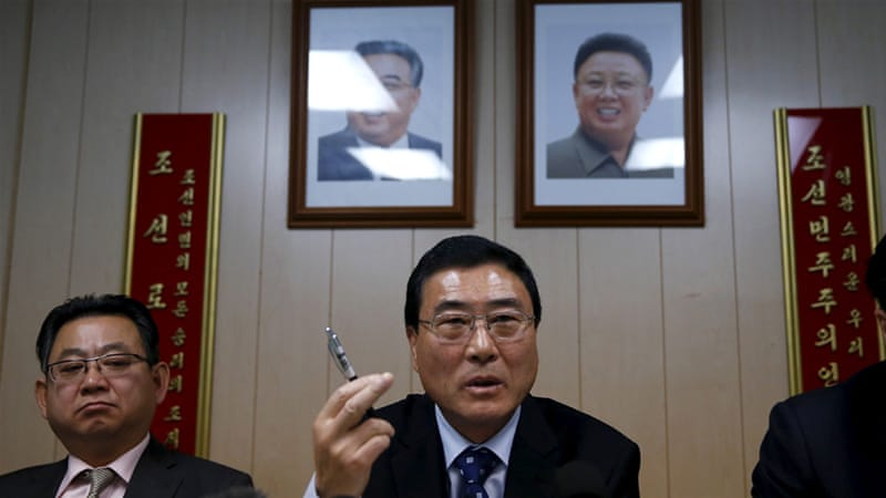 North Korean diplomat Choe Myong-nam, left, is seen at a press conference in this 2015 photo [Mike Segar/Reuters]