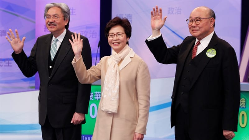 Chief Executive candidates, from left to right, John Tsang,  Carrie Lam and judge Woo Kwok-hing before a debate [Reuters/Bobby Yip]