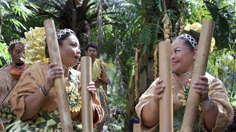 Indigenous Orang Asli dances are often accompanied by the drum of a bamboo pole [Kate Mayberry/Al Jazeera]