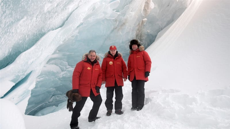 Russian President Vladimir Putin, Prime Minister Dmitry Medvedev and Defence Minister Sergey Shoigu during a visit to the cave of Arctic Pilots Glacier [Reuters]
