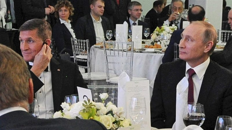 Flynn received $33,000 from RT to attend a 2015 gala in Moscow where he sat with President Putin [Kremlin Pool/EPA]