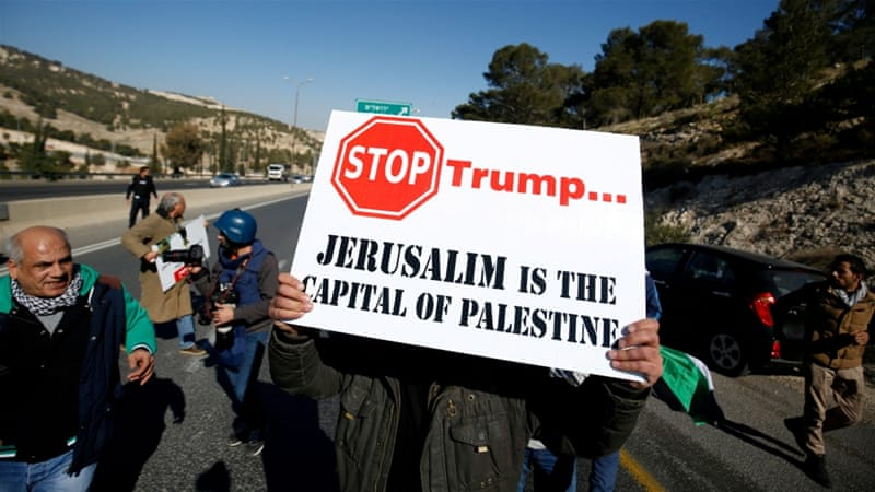 File: A Palestinian protests against a promise by Trump to relocate the US embassy to Jerusalem [Mohamad Torokman/Reuters]