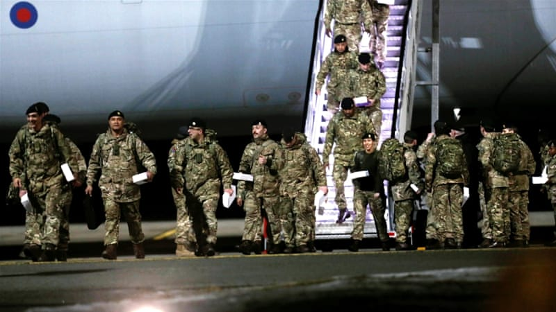 British soldiers, who are part of a NATO deterrent against Russia, arrive at Amari military airbase in Estonia on March 17 [Reuters/Ints Kalnins]
