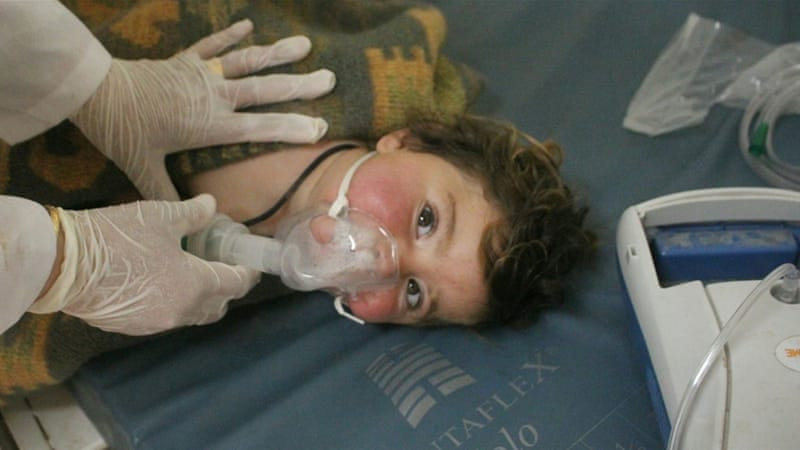 A child receiving treatment at a field hospital after an alleged chemical attack in the rebel-held town of Khan Sheikhoun in north Idlib province. [EPA]