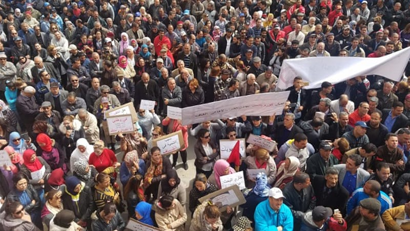 Tunisian protesters gather to strike over unemployment and poverty [File/AFP]