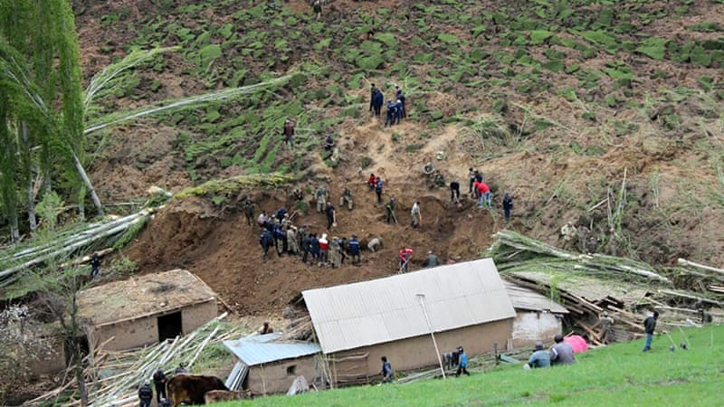 Major landslide buried six houses with families inside in the south of the Central Asian nation [Red Crescent Society of Kyrgyzstan/AFP]