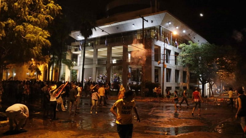 Protesters storm the National Congress in Asuncion on March 31 [EPA/Andres Cristaldo]
