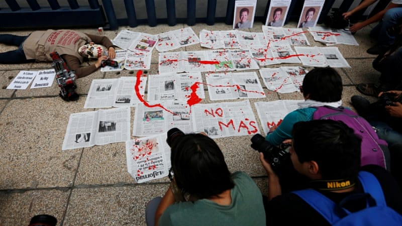 Activists protested against the murder of Miroslava Breach in Mexico City [Carlos Jasso/Reuters]