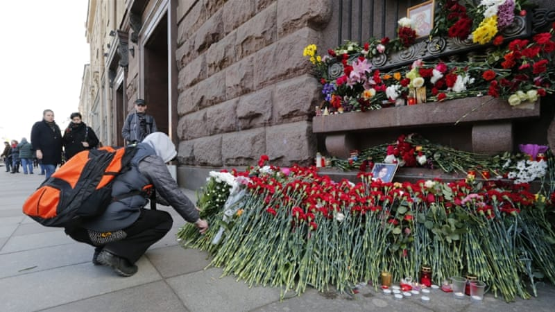 A man lays flowers outside Tekhnologicheskiy Institute metro station to pay tribute to victims of an explosion in St Petersburg metro on April 4 [EPA/Anatoly Maltsev]
