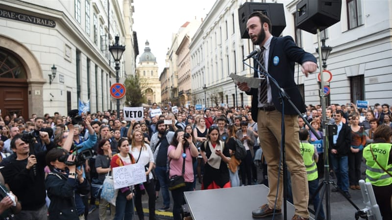 Student at the Central European University (CEU), Daniel Berg addresses demonstrators protesting against an amendment of the higher education law [EPA/Zoltan Balogh]