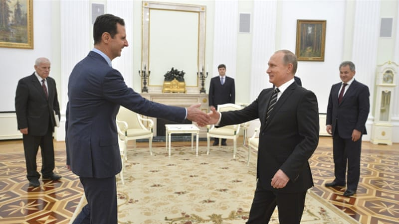 Russian President Vladimir Putin shakes hands with Syrian President Bashar al-Assad during a meeting at the Kremlin in Moscow on October 20, 2015 [Reuters/Alexei Druzhinin]
