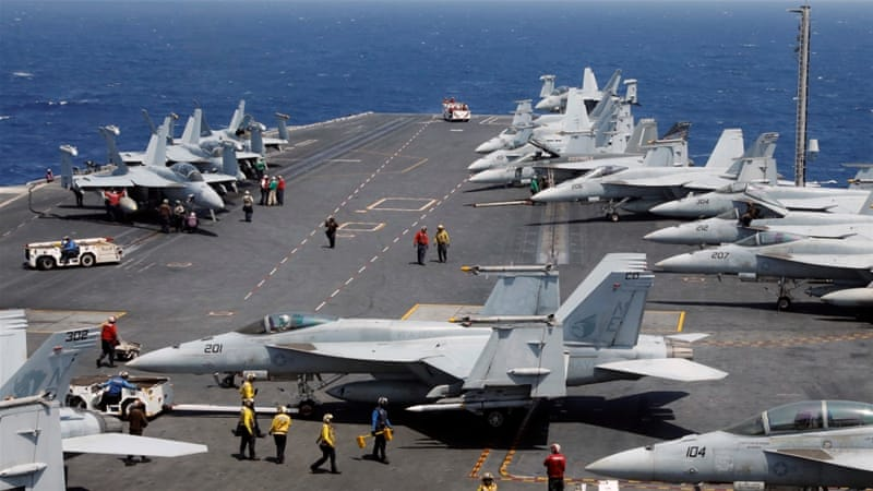 The Carl Vinson strike group includes an aircraft carrier [Erik De Castro/Reuters]