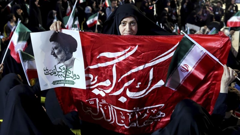 In the forthcoming election Hassan Rouhani will face two 'populist' candidates: Judge Ebrahim Raisi and military heavyweight  Mohammad Bagher Qalibaf, the current Mayor of Tehran [AP]