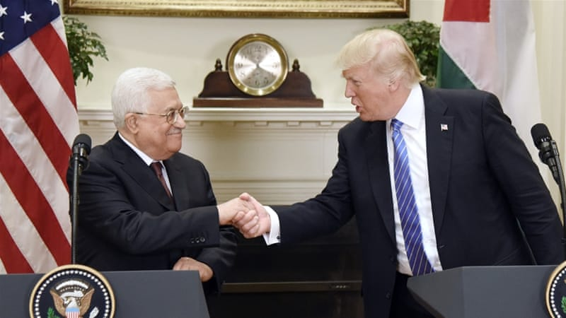 US President Donald Trump shakes hands with the President of the Palestinian Authority, Mahmoud Abbas, after a joint statement 