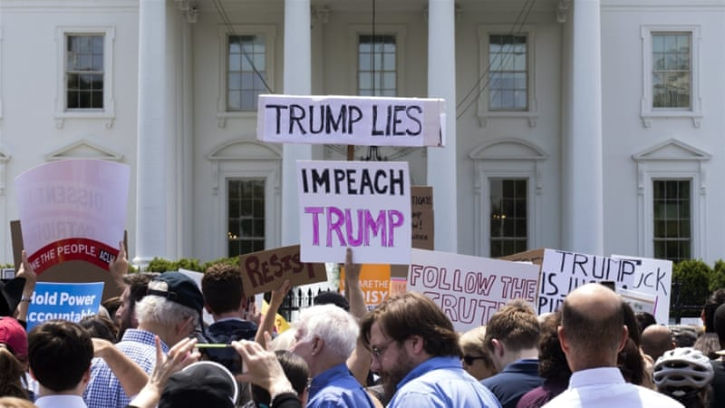 Protesters rally in opposition to President Donald Trump's firing of FBI Director James Comey at the White House in Washington, DC [Shayn thew/EPA]