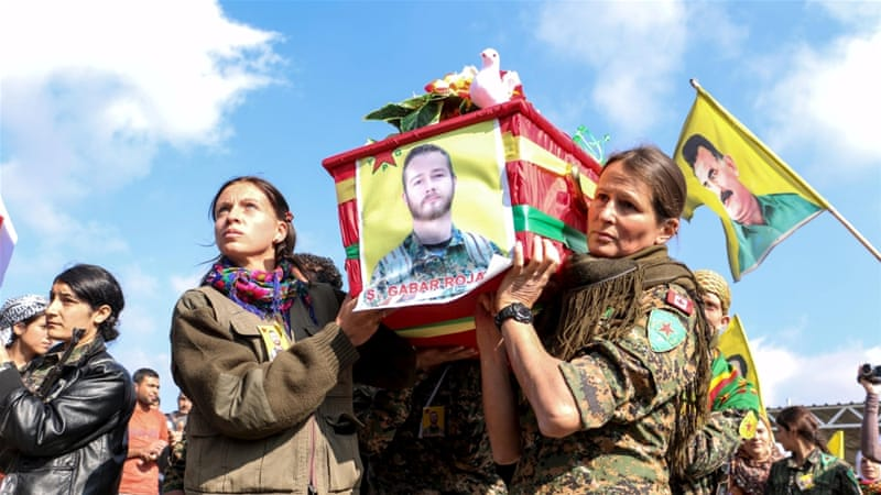 YPG fighters carry the coffin of fighter John Robert Gallagher, a Canadian who died in battle with ISIL fighters, during his funeral in Hasakah, Syria on November 12, 2015 [Reuters/Rodi Said]