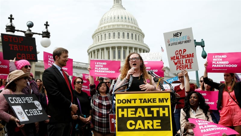 Protesters rally during US House voting on the American Health Care Act, which repeals major parts of the 2000 Affordable Care Act known as Obamacare on May 4 in Washington DC [Reuters/Yuri Gripas]