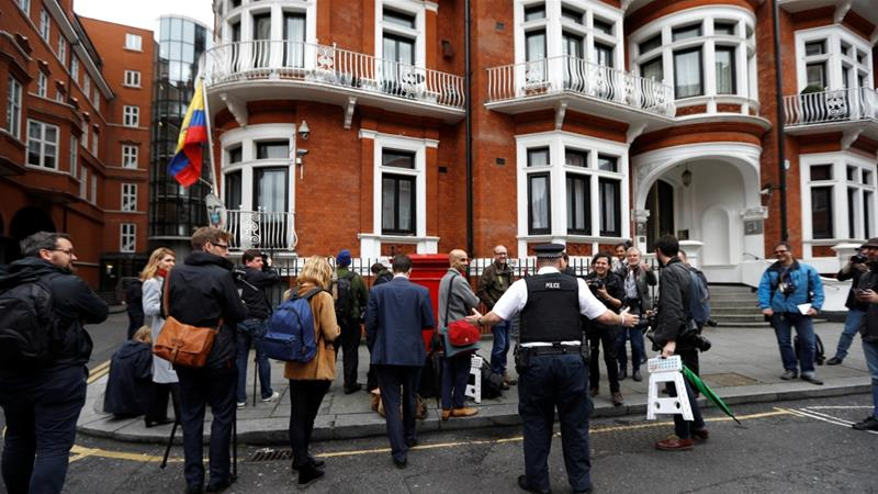Supporters march on embassy to fight for 'persecuted hero' Julian Assange