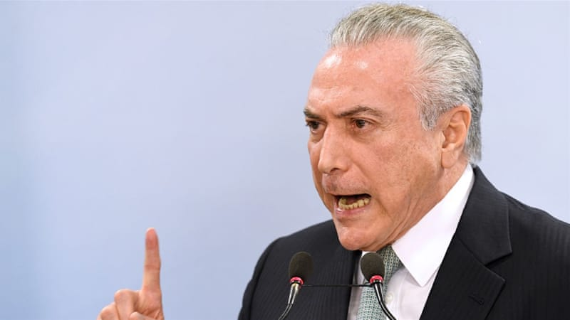Temer is wrapping up his term as one of the most unpopular Brazilian presidents in decades [Evaristo Sa/AFP]