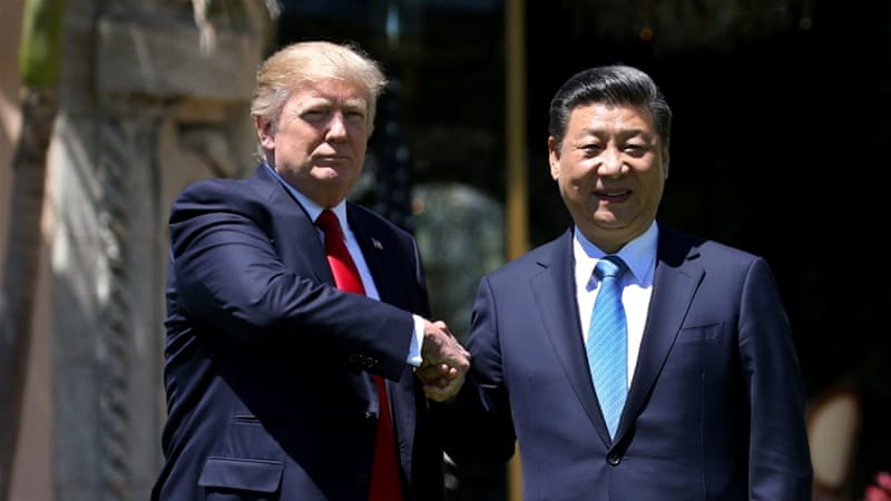 US President Donald Trump and China's President Xi Jinping shake hands at Mar-a-Lago estate in Florida [Carlos Barria/ Reuters]