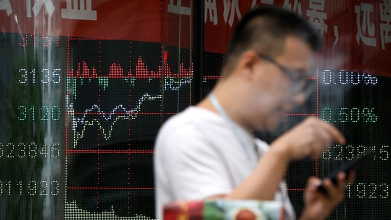 Beijing has identified the containment of financial risks and asset bubbles as a top priority this year [Andy Wong/AP]