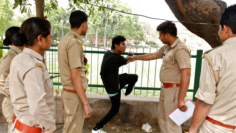 A youth is questioned by the 'anti-Romeo squad' - set up ostensibly