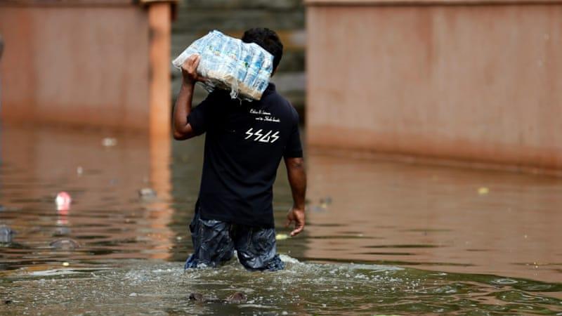 At least 100 killed in floods, landslides in Sri Lanka