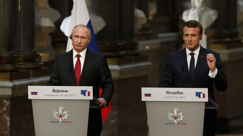 Emmanuel Macron and Vladimir Putin hold frank talks in Versailles