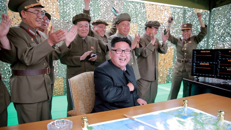 FILE: Kim Jong-un reacts during a test launch of ground-to-ground medium long-range ballistic rocket Hwasong-10 [Reuters]