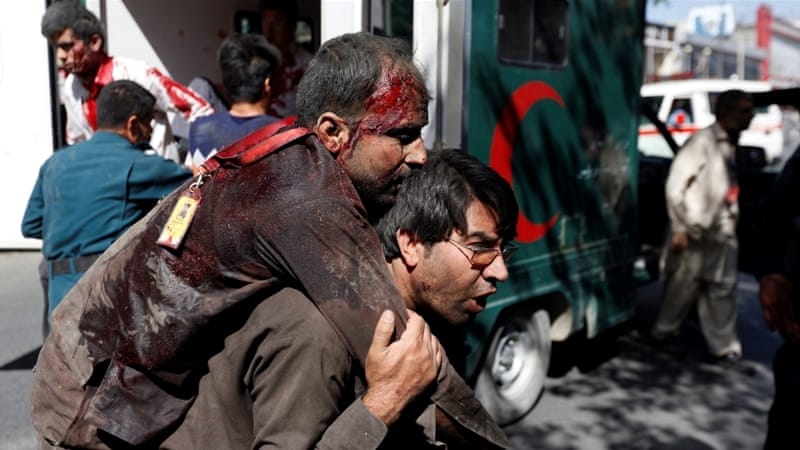 Wounded men arrive at a hospital in Kabul after the blast [Mohammad Ismail/Reuters]