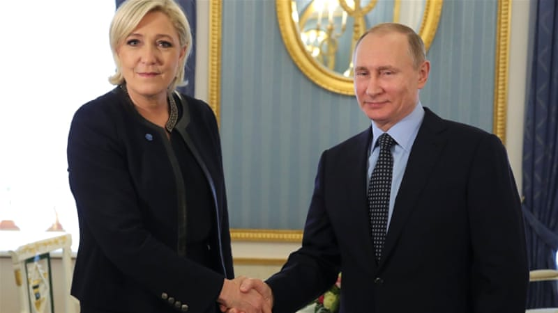 Russian President Vladimir Putin shakes hands with former French presidential election candidate Marine Le Pen during their meeting in Moscow on March 24, 2017 [Reuters]