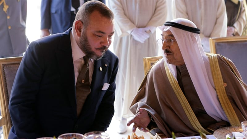 The Moroccan king, left, called on all parties to 'exercise restraint' [File: Youssef Boudlal/Reuters]