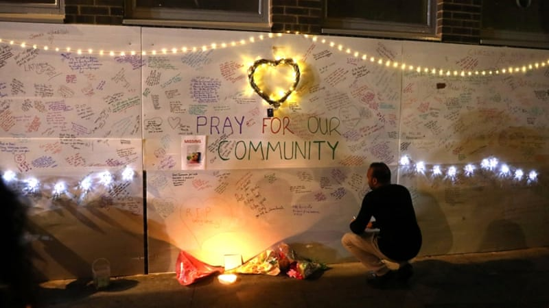 Condolence messages were left on a wall near Grenfell Tower, which caught fire on Wednesday [Reuters]