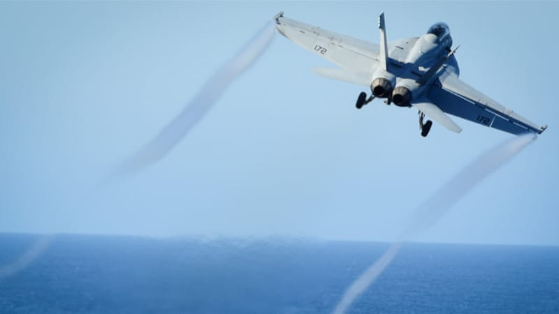 A file photo of an F/A-18E Super Hornet [US Navy/Seaman Weston A. Mohr via Reuters]