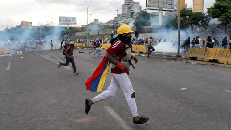 Protesters called for Maduro's resignation and new elections [Marco Bello/Reuters]
