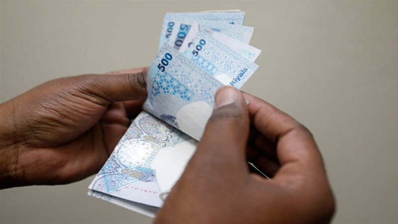 This week the riyal traded between offshore banks as low as 3.81 to the US dollar [Fadi al-Assaad/Reuters]
