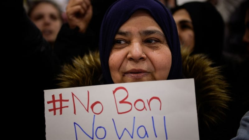 Refugee advocacy groups have slammed the the Supreme Court ruling that partially reinstates the Muslim ban [Charles Mostoller/Reuters]