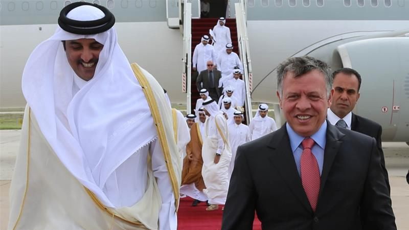Jordan's King Abdullah (R) walks with Qatar's Emir Sheikh Tamim Bin Hamad Al Thani after his arrival at Amman airport, March 30, 2014. REUTERS/Yousef Allan/Royal Palace