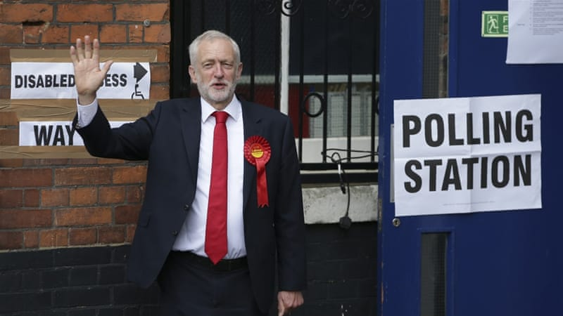 Britain's main opposition Labour Party leader Jeremy Corbyn arrives at a polling station to cast his vote in north London [Daniel Leal-Olivas/AFP]