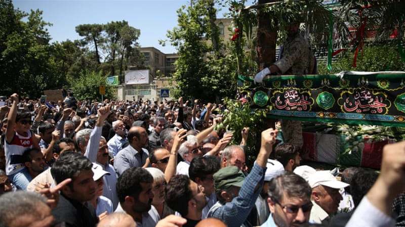 People attend the funeral of the victims who were killed on the June 7 attack at the Iranian parliament and Ayatollah Khomeini's mausoleum, in Tehran [Reuters]